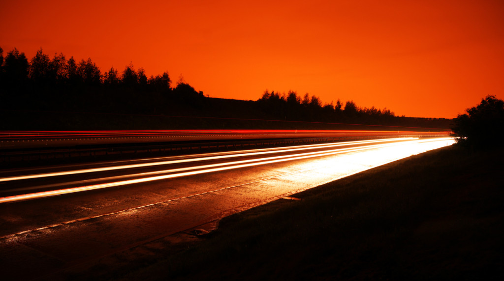 England – uk – One night on motor way – slow shutter speed – apocalyptic deep orange sky – carlos filipe flores
